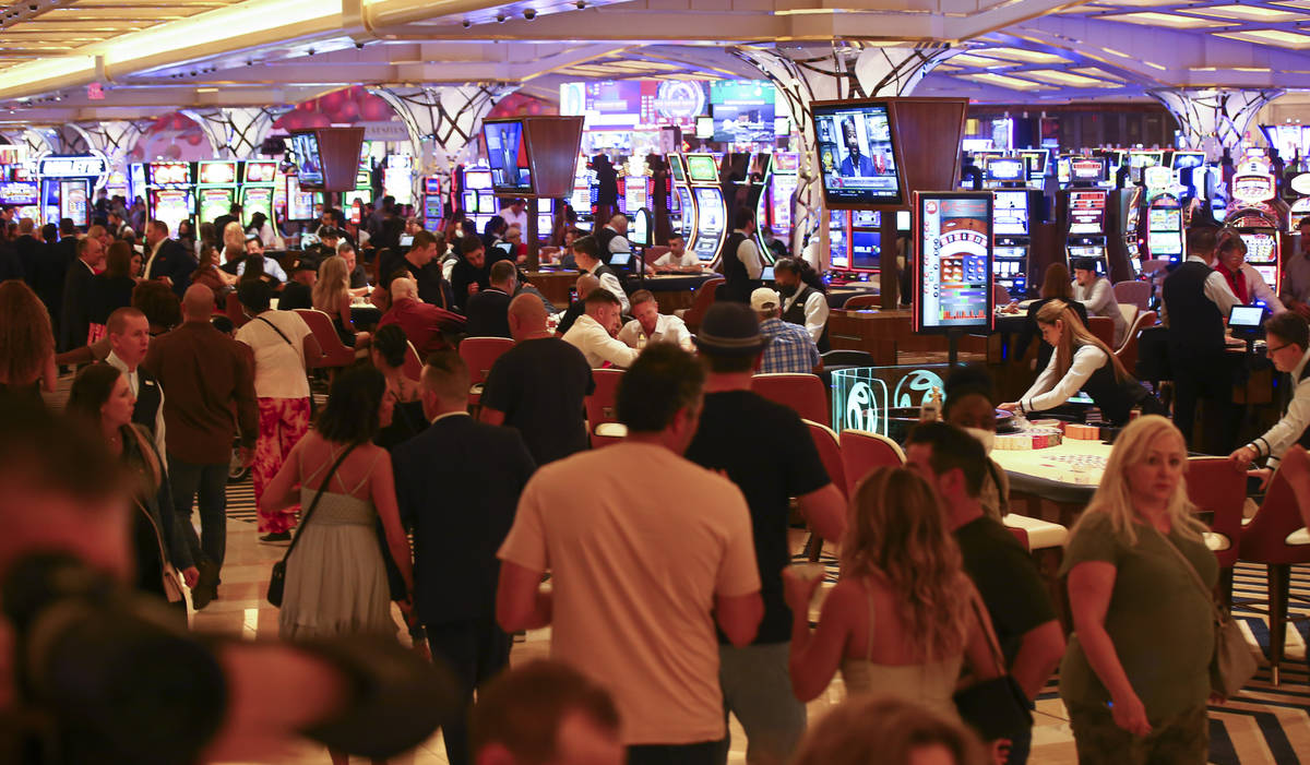 People gamble on the casino floor as Resorts World Las Vegas opens to the public on Thursday, J ...